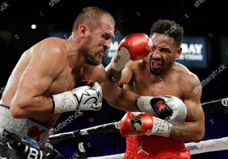 Andre Ward, right, hits Sergey Kovalev during a light heavyweight championship boxing match, in Las Vegas