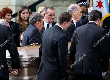 Former Chicago Mayor Richard M. Daley and family watch as the casket of former first lady Maggie Daley arrives at Old St. Patrick's Catholic Church in Chicago before her funeral service Monday, Nov., 28, 2011, Mrs. Daley died Nov. 24 after a long battle with cancer