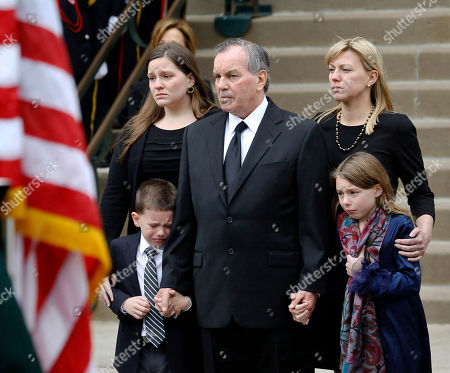 Former Chicago Mayor Richard M. Daley, flanked by his daughters Elizabeth, left, and Nora, right, and their children watch as the casket of former first lady Maggie Daley is taken from Old St. Patrick's Catholic Church in Chicago after her funeral service Monday, Nov., 28, 2011. Mrs. Daley died Nov. 24 after a long battle with cancer
