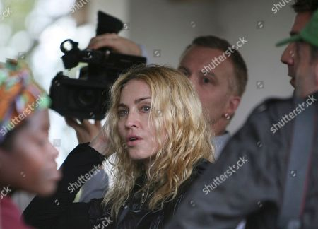 "Stock Photo of U.S. pop star Madonna visits Salaza village near Lilongwe, Malawi Friday, April, 3, 2009. In a surprise move, a judge on Friday rejected Madonna's request to adopt a second child from Malawi and said it would set a dangerous precedent to bend rules requiring that prospective parents live here for some period. The country's child welfare minister had come out Thursday in support of the pop superstar's application to adopt 3-year-old Chifundo ""Mercy"" James"