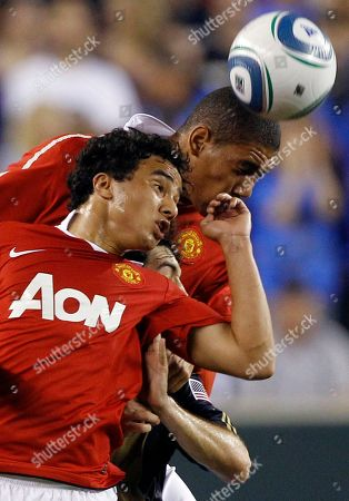 Martin Rivas, Rafael, Chris Smalling. Manchester United's Rafael, left, and teammate Chris Smalling, right, squeeze in Philadelphia Union's Martin Rivas, center, during the second half of a friendly soccer match, Philadelphia. Manchester won 1-0