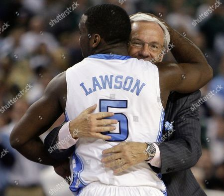 North Carolina head coach Roy Williams hugs Ty Lawson after their 89-72 win over Michigan State in the championship game at the men's NCAA Final Four college basketball tournament, in Detroit