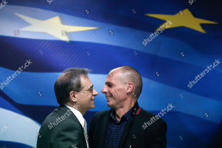 Stock Image of Gikas Hardouvelis, Yanis Varoufakis. Greece's outgoing Finance Minister Gikas Hardouvelis, left, kisses the new Finance Minister Yanis Varoufakis during a handover ceremony in Athens, . Greece's radical new government on Wednesday signaled the country would backtrack or scrap a series of budget measures its eurozone creditor nations had demanded in exchange for bailout loans