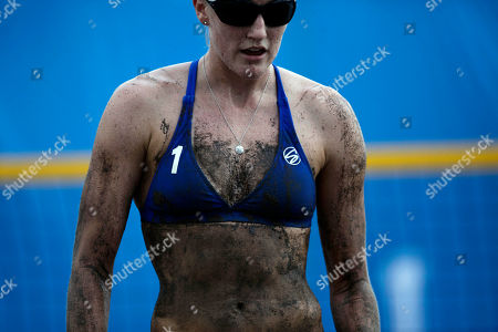 United State's Emily Day is covered with sweat and sand during a women's beach volleyball match against Guatemala at the Pan American Games in Puerto Vallarta, Mexico