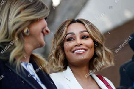 Blac Chyna, Lisa Bloom. Blac Chyna, right, and her attorney Lisa Bloom smile at a news conference outside a courthouse, in Los Angeles. A court commissioner has granted Chyna a temporary restraining order against her former fiancee, reality television star Rob Kardashian