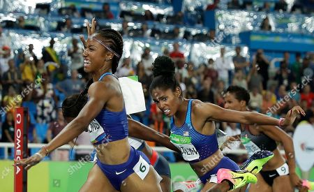 Brianna Rollins from the United States celebrates after winning the gold medal in the women's 100-meter hurdles final during the athletics competitions of the 2016 Summer Olympics at the Olympic stadium in Rio de Janeiro, Brazil