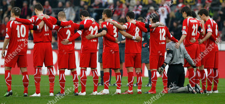 Cologne's goalkeeper Faryd Mondragon, 4rd right grey jersey, and his teammates stand in a minute of silence for German goalkeeper Robert Enke, who committed suicide on Nov.10,2009, prior to the German first division Bundesliga soccer match between FC Cologne and 1899 Hoffenheim in Cologne, Germany