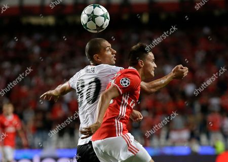 Gokhan Inler, Franco Cervi. Besiktas' Gokhan Inler, left, and Benfica's Franco Cervi jump for the ball during the Champions League group B soccer match between Benfica and Besiktas at the Luz stadium in Lisbon