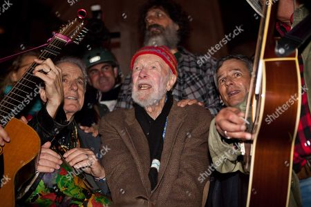 "Activist musician Pete Seeger, 92, center, sings before a crowd of nearly a thousand demonstrators sympathetic to the Occupy Wall Street protests at a brief acoustic concert in Columbus Circle, in New York. The demonstrators marched down Broadway singing ""This Little Light of Mine"" and other folk and gospel songs while ad-libbing lines about corporate greed and social justice"