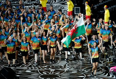 Team Wales flag bearer Jazz Carlin leads her team into Carrara Stadium for the opening ceremony for the 2018 Commonwealth Games on the Gold Coast, Australia