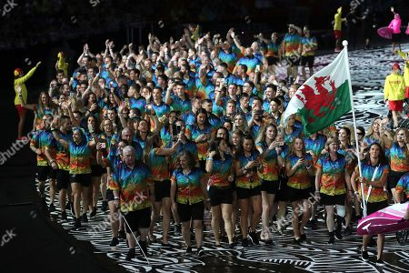 Stock Photo of Team Wales flag bearer Jazz Carlin leads her team into Carrara Stadium for the opening ceremony for the 2018 Commonwealth Games on the Gold Coast, Australia
