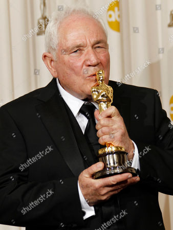 """David Seidler poses backstage with the Oscar for best original screenplay for """"The King's Speech"""" at the 83rd Academy Awards, in the Hollywood section of Los Angeles"""