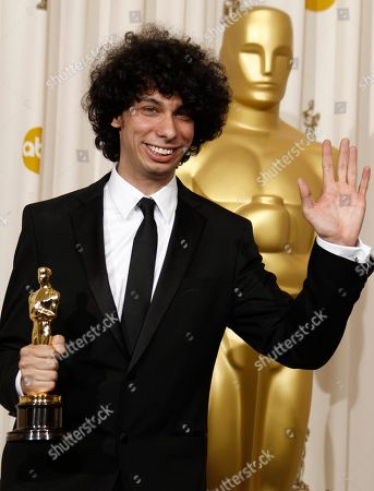 "Luke Matheny poses backstage with the Oscar for best live action short film for ""God of Love"" at the 83rd Academy Awards, in the Hollywood section of Los Angeles"