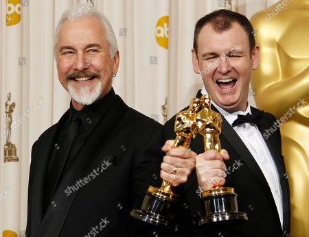 """Rick Baker, Dave Elsey. Rick Baker, left, and Dave Elsey pose backstage with the Oscar for best makeup for """"The Wolfman"""" at the 83rd Academy Awards, in the Hollywood section of Los Angeles"""