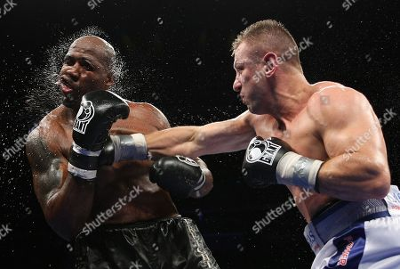 Tomasz Adamek, Travis Walker. Tomasz Adamek, right, of Poland, lands a punch on Travis Walker during the fifth round of a heavyweight boxing match at the Prudential Center in Newark, N.J., . Adamek won by TKO in five rounds