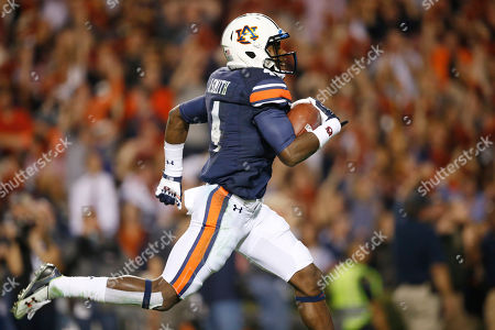 Auburn wide receiver Jason Smith (4) runs to score a touchdown during the second half of an NCAA college football game against Alabama, in Auburn, Ala