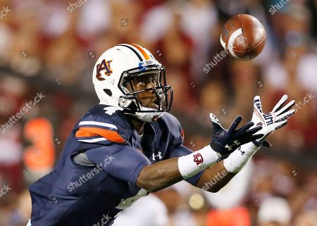 Auburn wide receiver Jason Smith (4) tips a pass to himself before scoring a touchdown during the second half of an NCAA college football game against Alabama, in Auburn, Ala