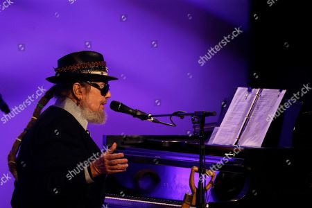 Dr. John performs during a funeral tribute to Allen Toussaint in New Orleans, . New Orleans and lovers of New Orleans' rich musical heritage crowded into the historic Orpheum theater Friday and bid goodbye in words and song to Toussaint, a prolific songwriter, performer and producer who died last week at age 77