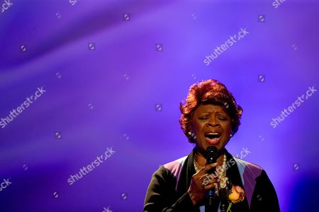 Singer Irma Thomas performs during a funeral tribute to Allen Toussaint in New Orleans, . New Orleans and lovers of New Orleans' rich musical heritage crowded into a historic theater Friday and bid goodbye in words and song to Toussaint, a prolific songwriter, performer and producer who died last week at age 77