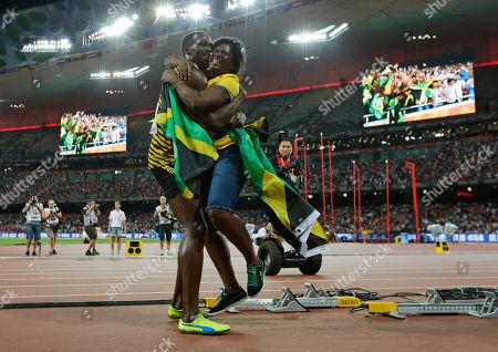 Jamaica's Usain Bolt hugs his mom, Jennifer Bolt, after winning the men's 100m final at theWorld Athletics Championships at the Bird's Nest stadium in Beijing