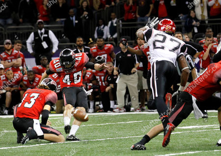 Louisiana-Lafayette kicker Brett Baer (40)kicks a 50-yard field goal at the end of regulation to beat San Diego State in the New Orleans Bowl NCAA college football game in New Orleans, . Louisiana-Lafayette won 32-30