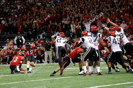 Louisiana-Lafayette kicker Brett Baer (40) kicks a 50-yard field goal at the end of regulation to beat San Diego State in the New Orleans Bowl NCAA college football game in New Orleans, . Louisiana-Lafayette won 32-30