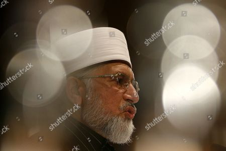 """Muhammad Tahir-ul-Qadri, a former Pakistani lawmaker speaks at the UK launch of a fatwa which bans suicide bombing """"without any excuses, any pretexts, or exceptions"""" in London, . The leader of a global Muslim movement has issued a voluminous religious ruling which he's touting as an absolute condemnation of terrorism. Tahir-ul-Qadri is the founder of Minhaj-ul-Quran, a worldwide movement that promotes a non-political, tolerant Islam"""
