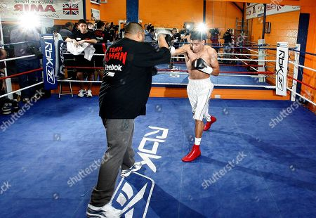 British boxer Amir Khan, is seen training at the Gloves Community Centre, Bolton, England, . Khan is due to fight Mexican Marco Antonio Barrera at the M.E.N Arena in Manchester on March 14