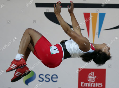 Zoe Smith of England does a back flip as she celebrates winning the gold medal in the women's 58 kg weightlifting competition the Commonwealth Games Glasgow 2014, in Glasgow, Scotland, Saturday, July, 26, 2014