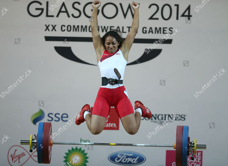 Zoe Smith of England leaps for joy as she wins the gold medal in the women's 58 kg weightlifting competition the Commonwealth Games Glasgow 2014, in Glasgow, Scotland