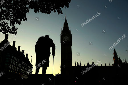 A statue of Winston Churchill is silhouetted against the Houses of Parliament and the early morning sky in London, . Britain entered uncharted waters Friday after the country voted to leave the European Union, according to a projection by all main U.K. broadcasters