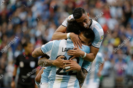 Argentina's Victor Cuesta, center, is congratulated by Ezequiel Lavezzi, front, and Ramiro Funes Mori after scoring his side's third goal against Bolivia during a Copa America Centenario Group D soccer match, at CenturyLink Field in Seattle