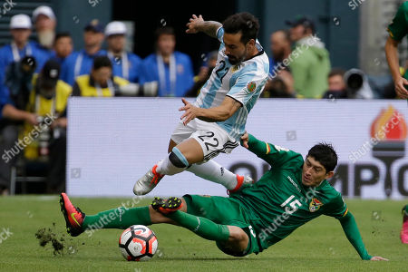 Argentina's Ezequiel Lavezzi, left, and Bolivia's Pedro Azogue fight for the ball during a Copa America Centenario Group D soccer match, at CenturyLink Field in Seattle
