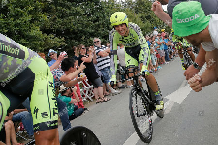 In this image Italy's Ivan Basso, left, trails behind his Tinkoff Saxo team with Spain's Alberto Contador, right, during the ninth stage of the Tour de France cycling race, a team time-trial over 28 kilometers (17.4 miles) with start in Vannes and finish in Plumelec, France. Veteran Basso, a two-time Giro d'Italia winner and once a great rival of Lance Armstrong, has announced that he has cancer in his left testicle and is dropping out of the Tour de France. Basso says he felt pain in his left testicle after a crash in Stage 5 and a medical check later revealed the cancer