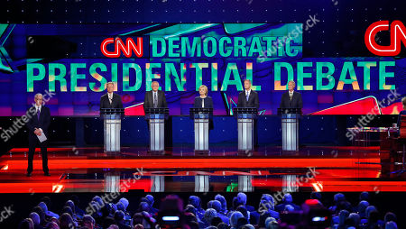 Democratic presidential candidates from left, former Virginia Sen. Jim Webb, Sen. Bernie Sanders, of Vermont, Hillary Rodham Clinton, former Maryland Gov. Martin O'Malley, and former Rhode Island Gov. Lincoln Chafee take the stage before the CNN Democratic presidential debate, in Las Vegas. On the far left is moderator Anderson Cooper