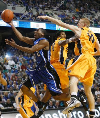 Nolan Smith, Brian Cole, David Williams. Duke's Nolan Smith (2) drives past North Carolina-Greensboro's Brian Cole (50) and David Williams (00) during the first half of an NCAA college basketball game in Greensboro, N.C