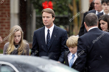 Stock Image of Former Democratic presidential candidate John Edwards and his children, Emma Claire, left, Jack and Cate, far right, leave the funeral service for Elizabeth Edwards at Edenton Street United Methodist Church in Raleigh, N.C., . Edwards died Tuesday of cancer at the age of 61