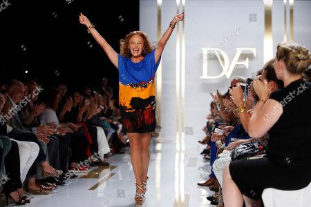 Stock Image of Designer Diane von Furstenburg acknowledges the audience after the Diane von Furstenburg Spring 2014 collection show during Fashion Week, in New York