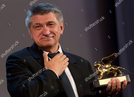 Director Aleksandr Sokurov holds the Golden Lion for best film for Faust, during the award ceremony of the 68th edition of the Venice Film Festival in Venice, Italy