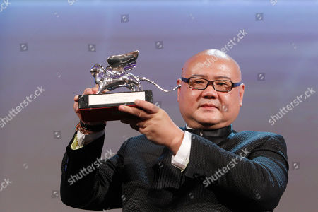 Director Cai Shangjun with the Silver Lion award for Best Director for the film People Mountain people Sea during the award ceremony of the 68th edition of the Venice Film Festival in Venice, Italy