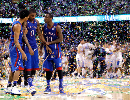 Stock Picture of Kansas forward Thomas Robinson (0), guard Tyshawn Taylor (10) and forward Kevin Young, left, after the NCAA Final Four tournament college basketball championship game, in New Orleans. Kentucky won 67-59