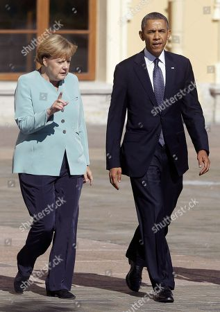 Stock Image of Barack Obama, Angela Merkel, Bob Carr. President Barack Obama walks with German Chancellor Angela Merkel prior to the group photo at the G-20 summit at the Konstantin Palace in St. Petersburg, Russia