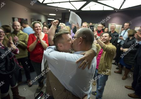 Clifton Webb, Chris Serrano. Chris Serrano, left, and Clifton Webb kiss after being married, as people wait in line to get licenses outside of the marriage division of the Salt Lake County Clerk's Office in Salt Lake City, . A federal judge ruled on Friday that Utah's ban on same-sex marriage is unconstitutional