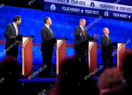 Republican presidential candidates, from left, Bobby Jindal, Rick Santorum, George Pataki, and Lindsey Graham take the stage during the CNBC Republican presidential debate at the University of Colorado, in Boulder, Colo