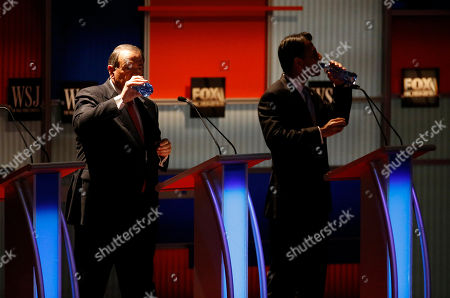 Mike Huckabee, Bobby Jindal. Mike Huckabee, left, and Bobby Jindal drink water during a commercial break at Republican presidential debate at Milwaukee Theatre, in Milwaukee
