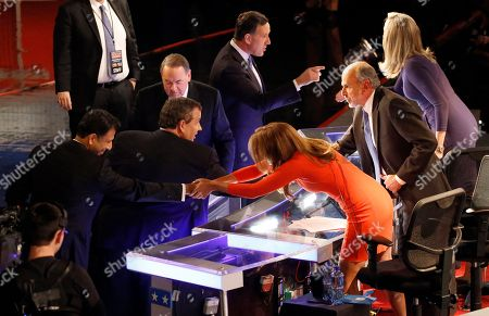Trish Regan, Gerald Seib, Sandra Smith. Bobby Jindal, left, Chris Christie, Mike Huckabee and Rick Santorum talk to moderators Trish Regan, Gerald Seib and Sandra Smith, right, after a Republican presidential debate at Milwaukee Theatre, in Milwaukee