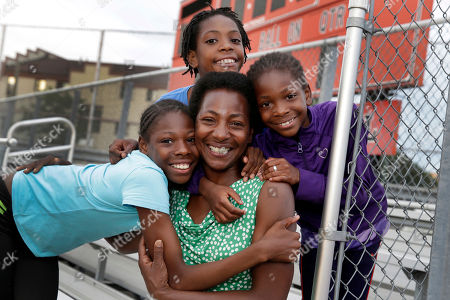 Tonia Handy, Tai Sheppard, Rainn Sheppard, Brooke Sheppard. Tonia Handy, 46, is surrounded by her children, Tai Sheppard, 11, Rainn Sheppard, 10, and Brooke Sheppard, 8, left to right, after track workouts at Boys and Girls High School, in Brooklyn borough of New York. Every morning, three young sisters wake up together with their mom in one bed in a Brooklyn homeless shelter. Every afternoon, they train in a sport that they hope will put them on a path to a better life. The girls have blossomed since taking up track and field just a year and a half ago, rising to the top tier of their age-group national rankings and earning a spot in the Junior Olympic Games, now underway in Houston