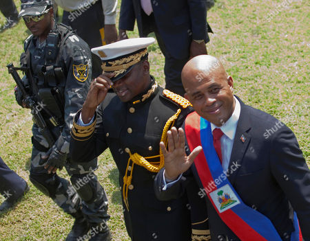"Michel Martelly, Mario Andresol. Haiti's newly-sworn-in President Michel Martelly, right, walks with Haiti's Chief of Police Mario Andresol during Haiti's presidential inaugural ceremony at the National Palace in Port-au-Prince, Haiti, . The 50-year-old performer known to Haitians as ""Sweet Micky"" was swept to power in a March 20 presidential runoff by Haitians tired of past leaders who failed to provide even basic services, such as decent roads, water and electricity in the Western Hemisphere's poorest country"