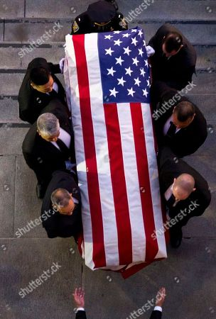 The casket of San Francisco Mayor Ed Lee is carried into City Hall, in San Francisco, Calif. Lee died Tuesday. He was San Francisco's first Asian-American mayor and presided over the city as it climbed out of a recession and into a boomtown driven by tech