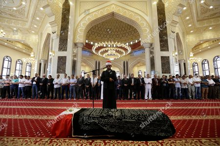 """Mourners pray over the coffin of Egyptian actor Omar Sharif for a funeral procession at the Hussein Tantawi Mosque in Cairo, Egypt, . Sharif, the Egyptian-born actor with the dark, soulful eyes who soared to international stardom in movie epics, """"Lawrence of Arabia"""" and """"Doctor Zhivago,"""" died in a Cairo hospital of a heart attack, on Friday, July 10. He was 83"""